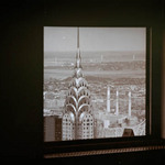 A photograph of a view of the Chrysler Building taken from a window of the Empire State Building