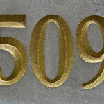 photo of gilded number incised in stone