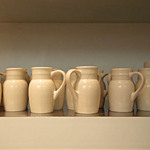 photo of glazed cream colored jugs