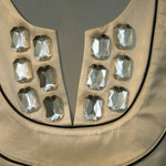 photo of a dress close up with baguette cut stones inlaid in the neckline
