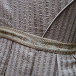 photo of detail of a grey kimono with belt