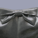 photo of a strapless grey dress with a large bow at the front