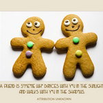 two gingerbread men holding hands