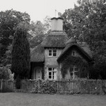 a photograph of a Victorian thatched cottage near Longleats, Warminster, Wiltshire, England