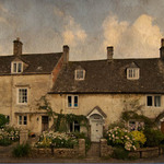 a photograph of a row of stone cottages in the Cotswolds, England