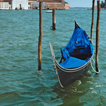 a photograph of a gondola in the canal beside St. Mark's Square in Venice, Italy