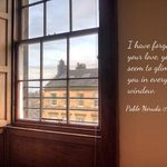 View from window with quote by Pablo Neruda 'I have forgotten your love, and yet I seem to glimpse you in every window.'