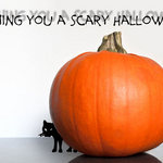 pumpkin with cat peeking out from behind and 'Have A Scary Halloween'