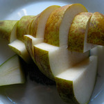 a photo of an artistically sliced pear