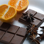 photo of star anise, slices of orange, and chocolate