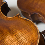 photo of two violins close up