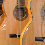 photo of two acoustic Spanish guitars