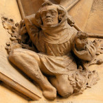 photo of a stone gargoyle of a kneeling man