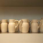 photo of glazed cream colored jugs