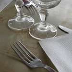 photo of a fork, wine glasses and napkin in a place setting
