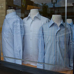 photo of a window displaying mannequins with men's shirts