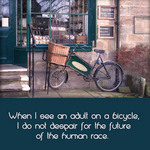 photo of a bicycle leaning against a shop front with a quote about people and bicycles by H.G. Wells