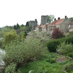 a photograph of a scene by the riverside in a village in North Yorkshire